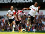 Sadio Mane of Southampton battles for the ball with Younes Kaboul of Spurs during the Barclays Premier League match on October 5, 2014