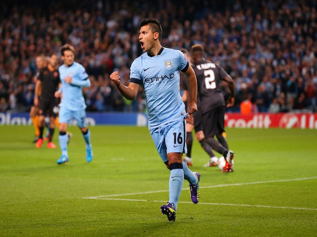 Sergio Aguero of Manchester City celebrates scoring the opening goal from a penalty kick during the UEFA Champions League Group E match against Roma on September 30, 2014