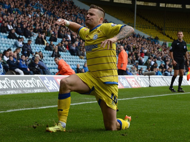 Chris Maguire of Sheffield Wednesday celebrates after scoring their first goal during the Sky Bet Championship match between Leeds United and Sheffield Wednesday at Elland Road on October 4, 2014