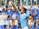 Lazio's midfielder Stefano Mauri celebrates after scoring against during the Italian Serie A football match Lazio vs Sassuolo on October 5, 2014