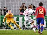 Bayern Munich's midfielder Thomas Mueller (C) scores from the penalty spot past CSKA Moscow's goalkeeper Igor Akinfeev (L) during a Group E Champions league football match on September 30, 2014