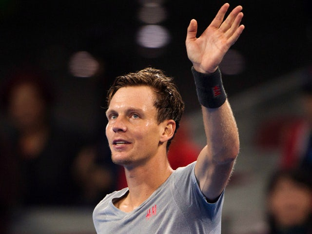 Tomas Berdych of the Czech Republic waves to the crowd after beating Martin Klizan of Slovakia during their men's singles semi-final match at the China Open tennis tournament in the National Tennis Center of Beijing on October 4, 2014