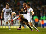 Gokhan Tore of Besiktas and Vlad Chiriches of Spurs battle for the ball during the UEFA Europa League Group C match between Tottenham Hotspur FC and Besiktas JK at White Hart Lane on October 2, 2014
