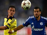 Schalke's Swiss midfielder Tranquillo Barnetta and Maribor´s Ales Mejac (L) vie for the ball during the first leg UEFA Champions League Group G football match FC Schalke 04 vs NK Maribor on September 30, 2014