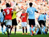 Wayne Rooney of Manchester United receives a straight red card by referee Lee Mason after a foul on Stewart Downing of West Ham during the Barclays Premier League match between Manchester United and West Ham United at Old Trafford on September 27, 2014