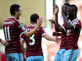 West Ham players, including Enner Valencia and Stewart Downing, celebrate after Nedum Onuoha of QPR scored an own goal during the Barclays Premier League match on October 5, 2014