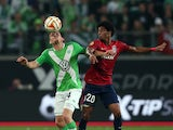 Wolfsburg's defender Sebastian Jung vies with Lille's Cap Verdian forward Ryan Mendes the UEFA Europa League group H football match between VfL Wolfsburg v LOSC Lille on October 2, 2014