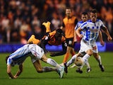 Nouha Dicko of Wolverhampton Wanderers is challenged by Jack Robinson and Jonathan Hogg of Huddersfield Town during the Sky Bet Championship match between Wolverhampton Wanderers and Huddersfield Town at Molineux on October 1, 2014