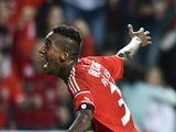 Benfica's Brazilian forward Anderson Talisca celebrates after scoring during the Portuguese Liga football match Benfica vs Arouca at Luz stadium in Lisbon on October 5, 2014
