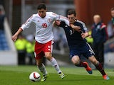 Andrew Robertson of Scotland battles for the ball with Giorgi Papava of Georgia during the EURO 2016 Qualifier match on October 11, 2014