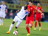 Macedonia's midfielder Arijan Ademi (R) vies with Luxembourg 's defender Christopher Martins Pereira (L) during the Euro 2016 group D qualifying football match on October 9, 2014