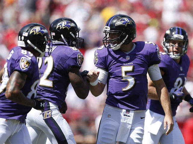 Torrey Smith #82 of the Baltimore Ravens celebrates with Joe Flacco #5 after a 15-yard touchdown reception in the first quarter of the game against the Tampa Bay Buccaneers at Raymond James Stadium on October 12, 2014
