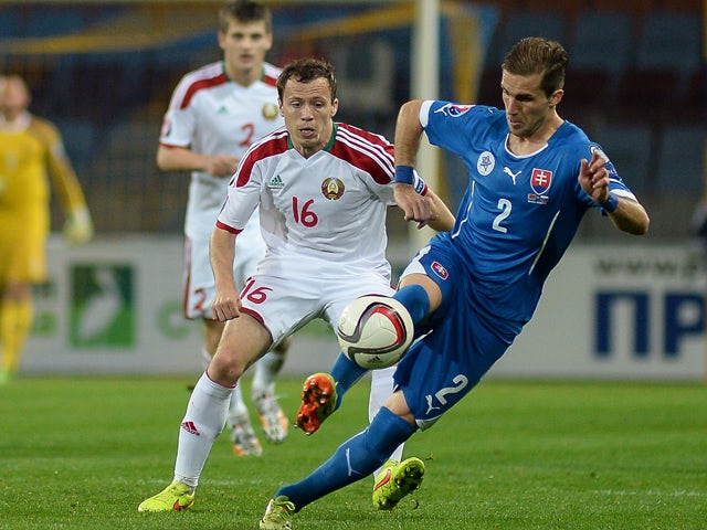 Slovakia's Peter Pekarik fights for the ball with Belarus' Sergei Balanovich during the UEFA Euro 2016 qualifying football match between Belarus and Slovakia in Borisov some 100 km from Minsk on October 12, 2014