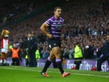 Ben Flower of Wigan walks from the pitch after receiving a red card during the First Utility Super League Grand Final match between St Helens and Wigan Warriors at Old Trafford on October 11, 2014