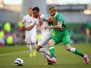 Brian Perez of Gibraltar is marshalled by James McClean of Republic of Ireland during the EURO 2016 Qualifier match on October 11, 2014
