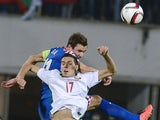 Croatia's Defender Darijo Srna fights for the ball with Bulgaria's Midfielder Georgi Milanov during the Euro 2016 group H qualifying football match between Bulgaria and Croatia at the Vassil Levski stadium in Sofia, Bulgaria on October 10, 2014