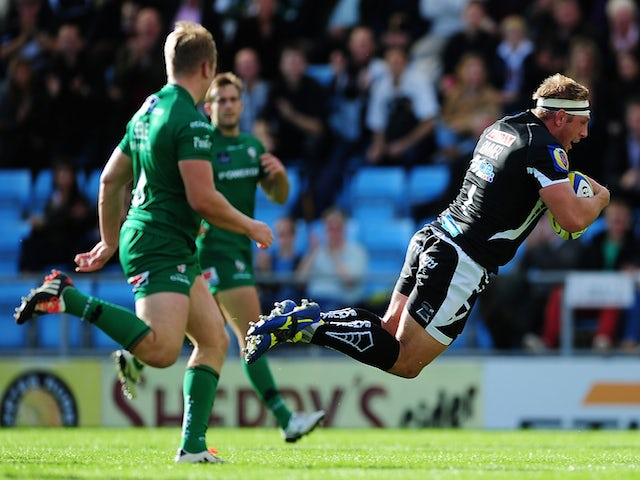 Carl Rimmer of Exeter Chiefs dives over for his side's opening try during the Aviva Premiership match between Exeter Chiefs and London Irish at Sandy Park on October 11, 2014