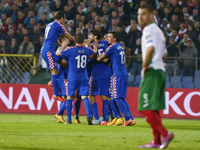 Croatia's players celebrate the own goal of Bulgaria during the Euro 2016 group H qualifying football match between Bulgaria and Croatia at the Vassil Levski stadium in Sofia, Bulgaria on October 10, 2014