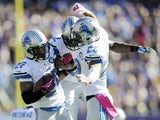 Glover Quin #27, Devin Taylor #92 and Darius Slay #23 of the Detroit Lions celebrate a interception by Quin during the first quarter of the game on October 12, 2014