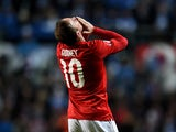 Wayne Rooney of England celebrates after scoring the opening goal from a free kick during the EURO 2016 Qualifier match between Estonia and England at A. Le Coq Arena on October 12, 2014