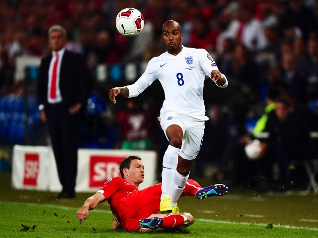 Fabian Delph of England is tackled by Stephan Lichtsteiner of Switzerland during the UEFA EURO 2016 Group E qualifying match between Switzerland and England at St Jakob-Park on September 8, 2014