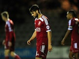 George Barker of Swindon Town looks dejected during the Johnstone's Paint Trophy second round match between Plymouth Argyle and Swindon Town at Home Park on October 7, 2014