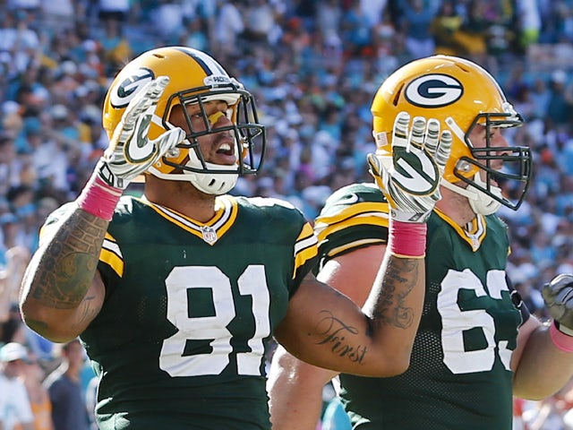 Tight end Andrew Quarless #81 of the Green Bay Packers celebrates his game-winning touchdown catch against the Miami Dolphins in the fourth quarter during a game at Sun Life Stadium on October 12, 2014