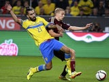 Sweden's midfielder Jimmy Durmaz (L) and Russia's defender Igor Smolnikov vie for the ball on October 9, 2014