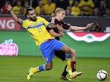 Sweden's midfielder Jimmy Durmaz (L) and Russia's defender Igor Smolnikov vie for the ball on October 9, 2014