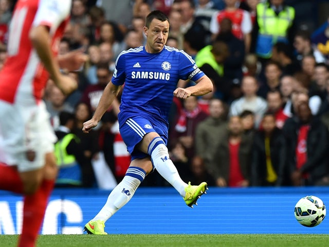 Chelsea's English defender John Terry passes the ball during the English Premier League football match between Chelsea and Arsenal at Stamford Bridge in London on October 5, 2014