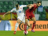 Juanfran (R) of Spain vies for a ball with Juraj Kucka of Slovakia during Euro 2016 qualifing football match between Slovakia and Spain in northern Slovak town of Zilina on October 9, 2014