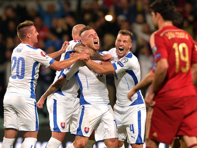Juraj Kucka (C) of Slovakia celebrates his goal during Euro 2016 qualifing football match between Slovakia and Spain in northern Slovak town of Zilina on October 9, 2014