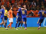 Kazakhstan's players celebrate after Renat Abdulin scored during the Euro 2016 qualifying match between the Netherlands and Kazakhstan in Amsterdam, on October 10, 2014