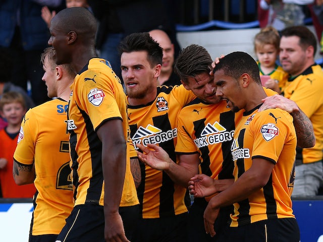 Kwesi Appiah of Cambridge celebrates with team mates after scoring his and the teams second goal of the game during the Sky Bet League Two match against Oxford United on October 11, 2014
