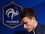 France's defender Laurent Koscielny arrives for a press conference in Clairefontaine-en-Yvelines on October 7, 2014