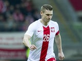 Poland's Lukasz Piszczek controls the ball during international friendly soccer match between Poland and Scotland at the National Stadium on March 5, 2014