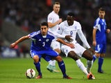 Manuel Battistini of San Marino evades Danny Welbeck of England during the EURO 2016 Group E Qualifying match between England and San Marino at Wembley Stadium on October 9, 2014