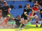Falcons player Mark Wilson makes a break to set up the third try during the Aviva Premiership match between London Welsh and Newcastle Falcons at Kassam Stadium on October 11, 2014