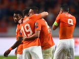 Holland's forward Ibrahim Afellay celebrates with teammates after scoring a goal during the Euro 2016 qualifying match between the Netherlands and Kazakhstan in Amsterdam, on October 10, 2014