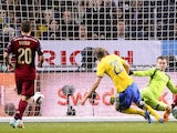 Sweden's forward Ola Toivonen scores past Russia's goalkeeper Igor Akinfeev on October 9, 2014