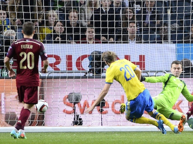 Sweden s forward Ola Toivonen scores past Russia s goalkeeper Igor Akinfeev  on October 9 0e2f3d77e2ba