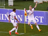Andy Keogh of the Glory celebrates his goal with teammate Joshua Risdon during the round one A-League match between Wellington Phoenix and Perth Glory at Westpac Stadium on October 12, 2014