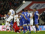 England's defender Phil Jagielka (3rd L) heads the ball to score his team's first goal during a Euro 2016 Qualifier football match between England and San Marino at Wembley Stadium on October 9, 2014