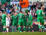Captain Robbie Keane of Republic of Ireland celebrates with team mates after scoring a goal during the EURO 2016 Qualifier match against Gibraltar on October 11, 2014