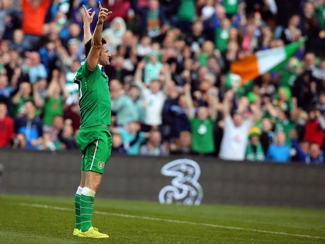 Republic of Ireland's striker Robbie Keane celebrates after scoring his team's second goal during a UEFA 2016 European Championship qualifing football match against Gibraltar on October 11, 2014