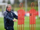 England manager Roy Hodgson looks truly petrified as two metal silhouettes attack him at St George's Park on October 8, 2014