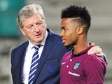 England manager Roy Hodgson (L) talks to midfielder Raheem Sterling at the A.Le Coq Arena in Tallinn, Estonia on October 11, 2014