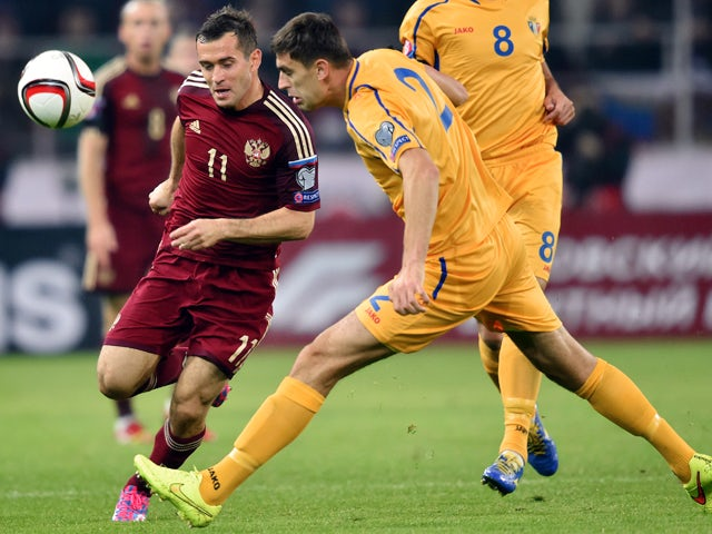 Russia's forward Aleksandr Kerzhakov fights for the ball with Moldova's midfielder Artur Ionita during the UEFA Euro 2016 qualifying football match between Russia and Moldova in Moscow on October 12, 2014