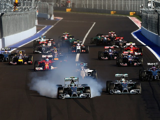 Nico Rosberg of Germany and Mercedes GP locks up approaching turn two next to Lewis Hamilton of Great Britain and Mercedes GP during the Russian Formula 1 Grand Prix at Sochi Autodrom on October 12, 2014