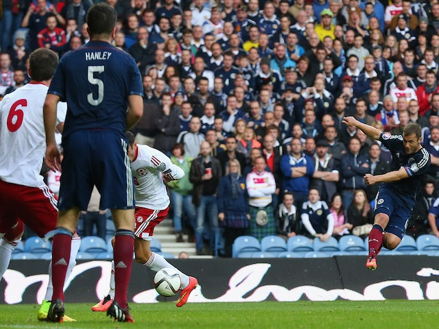 Shaun Maloney of Scotland fires in a shot which goes in off Akaki Khubutia of Georgia for an own goal to open the scoring during the EURO 2016 Qualifier match on October 11, 2014